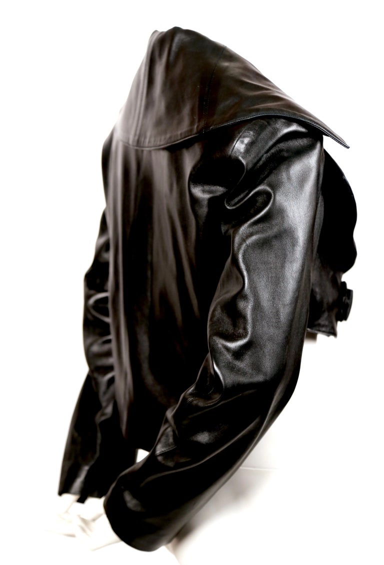 Jet black butter soft leather jacket with shawl collar and frog closure designed by Azzedine Alaia dating to fall of 1991. Labeled a FR 36. Approximate measurements: bust 36