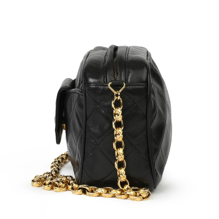 CHANEL Black Quilted Lambskin Vintage Timeless Fringe Camera Bag  Xupes Reference: HB3909 Serial Number: 1732164 Age (Circa): 1991 Accompanied By: Chanel Dust Bag, Box, Authenticity Card Authenticity Details: Authenticity Card, Serial Sticker (Made