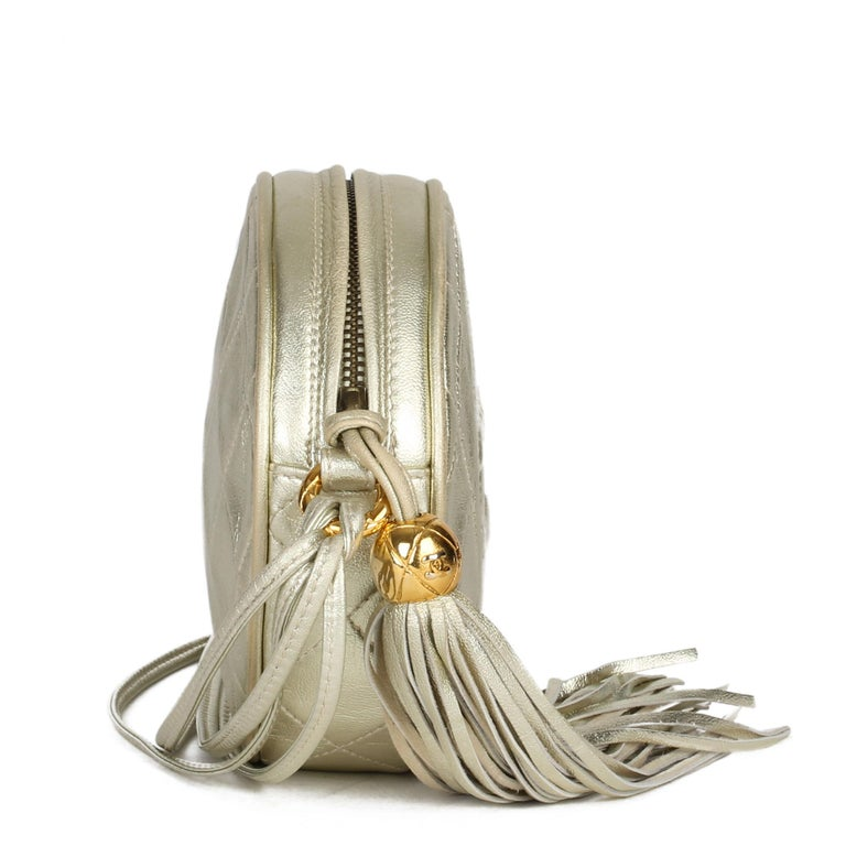 Women's 1991 Chanel Champagne Gold Lambskin Vintage Timeless Round Fringe Pochette For Sale
