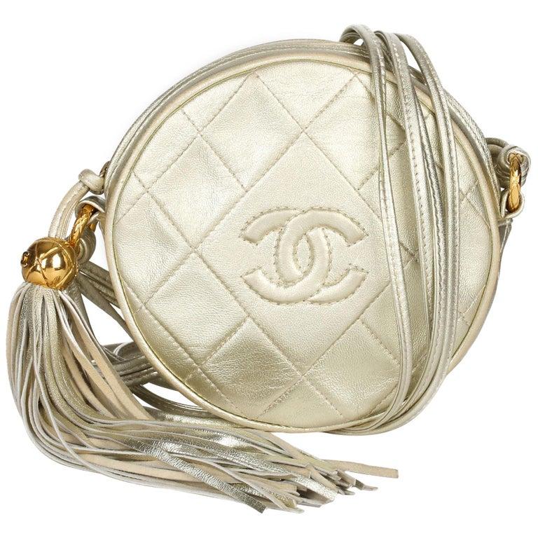 1991 Chanel Champagne Gold Lambskin Vintage Timeless Round Fringe Pochette For Sale