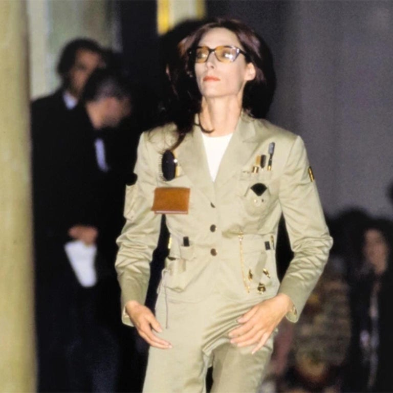 This is a very rare Spring Summer 1991 Franco Moschino Couture Khaki safari style Survival Jacket with tools to survive the urban jungle!  This iconic jacket was featured on the runway in our favorite Moschino show in October of 1990 for Spring /