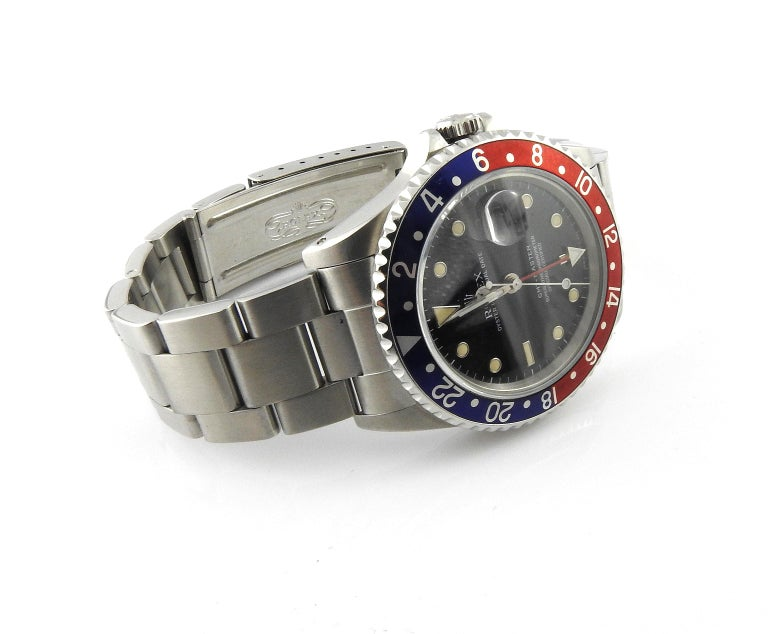 991 Rolex GMT - Master Pepsi Watch  Model: 16700 Serial: N304115  Pepsi bezel - red and blue - original to watch  40 mm stainless steel case  Black Dial  Stainless Steel Oyster Band - 7 3/4