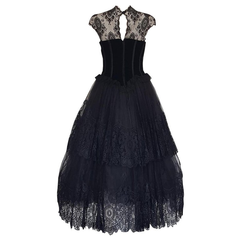 Spectacular dress by Valentino Boutique Year 1991 Incredible construction of lace and 7 different tulle flounces Black color Velvet bustier Two central bows Sleeveless Written size 10, but fits a S Japanese Queen has the same one but in red Made in