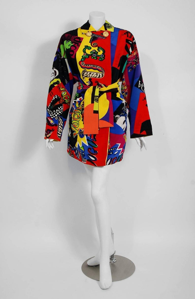 Red Vintage 1991 Versace Couture Colorful Vogue Print Reversible Belted Trench Coat For Sale
