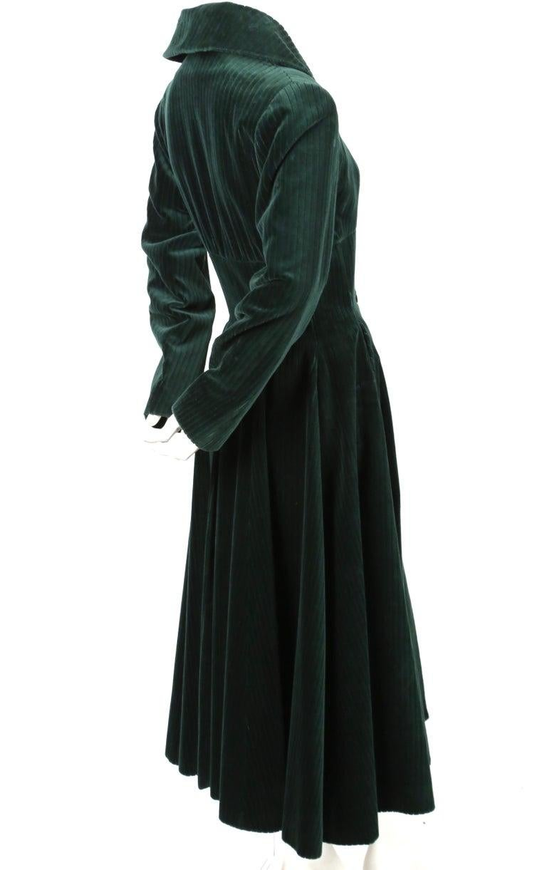 Very rare, deep-forest green, wide-wale velvet coat with corseted waist from Azzedine Alaia dating to fall of 1992 as seen on the runway. Coat is labeled a French 38 which best fits a size 4. Approximate measurements: shoulders 16.5