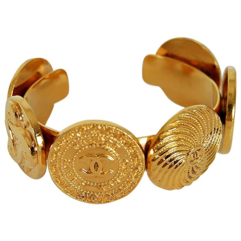 1992 Chanel Rare Novelty-Logo Button Charms Medallion Gold Cuff Bracelet For Sale