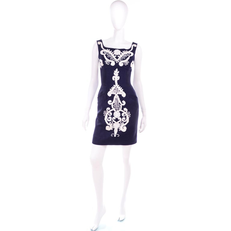 This is a stunning vintage Christian Lacroix sleeveless dress in a rich denim or midnight blue linen rayon blend.  The dress has gorgeous white soutache style embroidery and two functional front pockets.  The dress closes with a hook and eye above