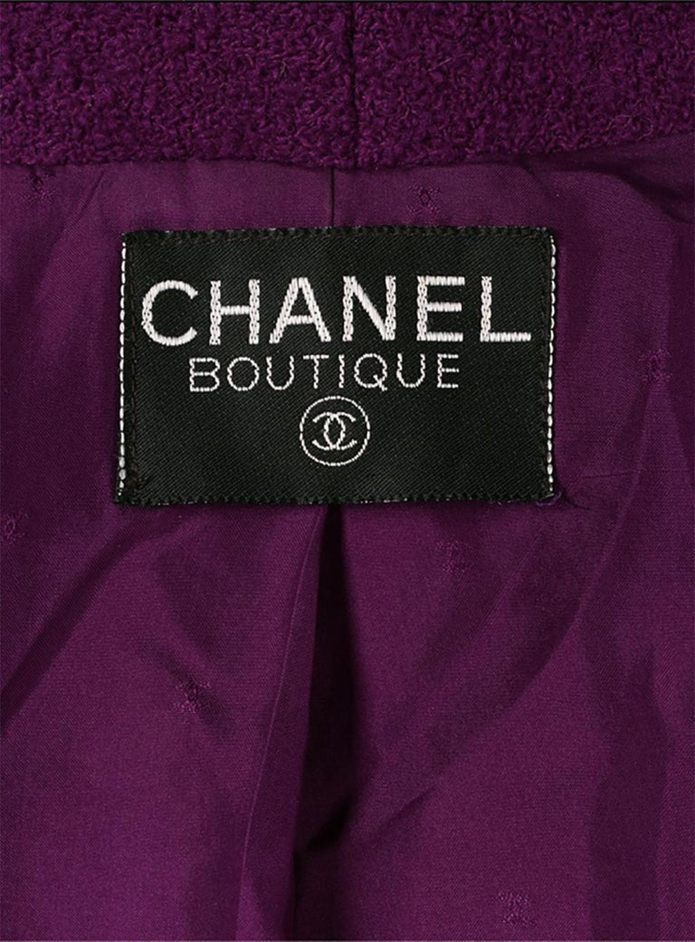 1993s Purple Chanel tweed wool boucle jacket featuring a shawl collar, a front logo button fastening with loops,  a silk logo lining, stitching details and a cropped length.  See 1993 Catwalk image. Estimated size 38fr/US6 /UK10 Composition: 100%