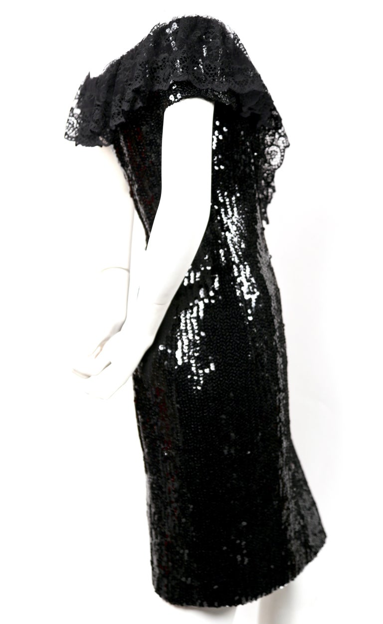 Jet-black sequined dress with chantilly lace collar and black satin bow from designed by Karl Lagerfeld for Chanel dating to 1994. Size label has been removed. Best fits a US 4-6. Approximate measurements: bust 34