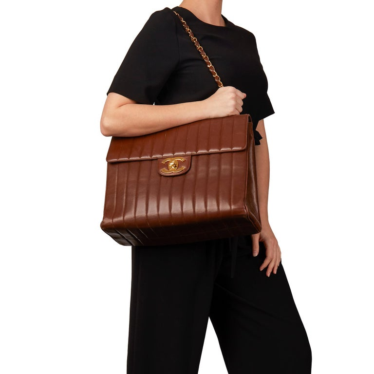 CHANEL Chocolate Brown Vertical Quilted Lambskin Vintage Maxi Jumbo XXL Flap Bag  Xupes Reference: HB3155 Serial Number: 2985965 Age (Circa): 1994 Authenticity Details: Date Stamp (Made in France) Gender: Ladies Type: Shoulder  Colour: