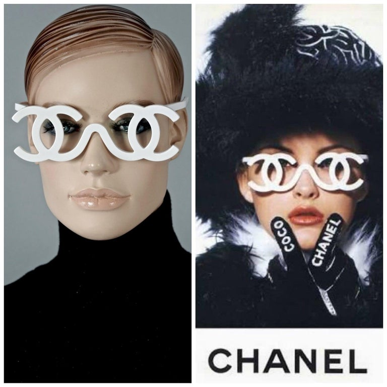 Measurements: Height: 2 inches (5 cm) Frame Width: 5.55 inches (14.1 cm) Arm:  5.19 inches (13.2 cm)  Vintage Chanel Runway Fall / Winter 1994 sunglasses.  Features: - 100% Authentic Vintage CHANEL.  - White openwork CC logo frame with no lenses. -