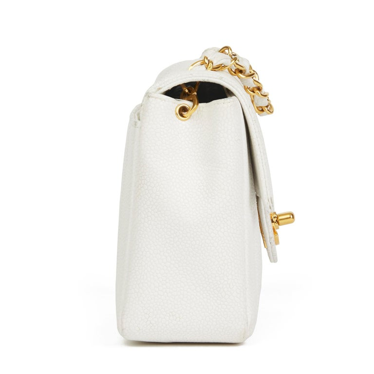 CHANEL White Quilted Caviar Leather Vintage Mini Flap Bag  Xupes Reference: HB2962 Serial Number: 2631523 Age (Circa): 1994 Accompanied By: Chanel Dust Bag, Box, Authenticity Card Authenticity Details: Serial Sticker, Authenticity Card (Made in