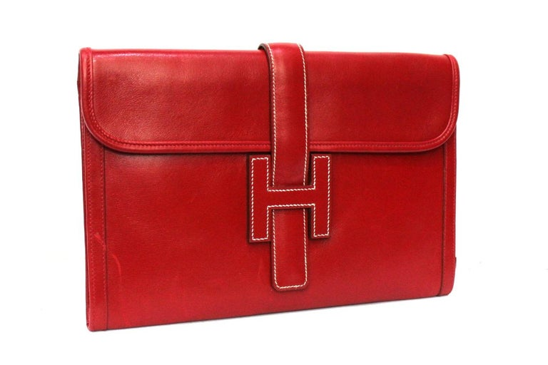 Hermès handbag model Jige made of smooth red leather with white stitching.  To be a 1994 product it is in good condition.