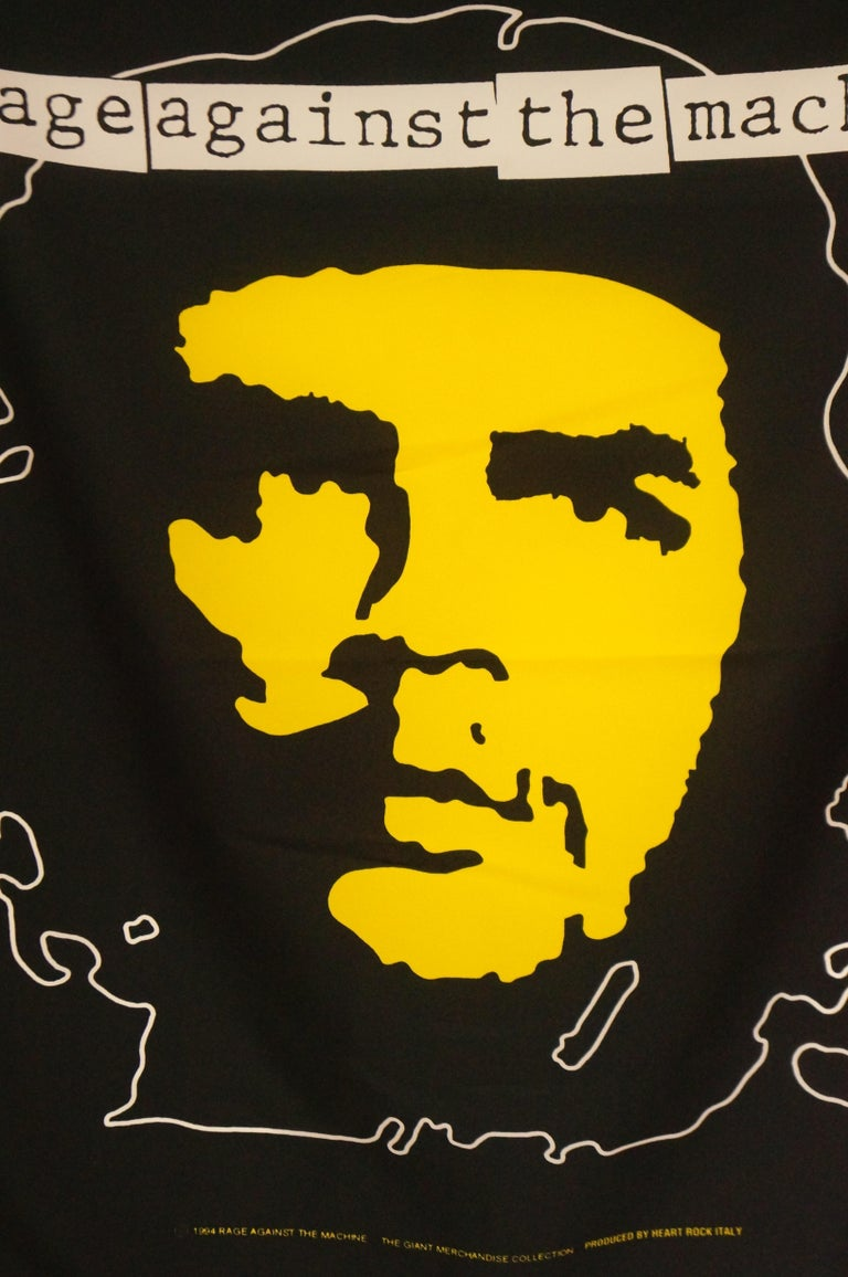 Rare 1994 Rage against the Machine wall flag scarf featuring a large graphic of Che Guevara. The scarf is primarily black with white and yellow screenprint graphics. The piece depicts Che Guevara in Alberto Korda's iconic