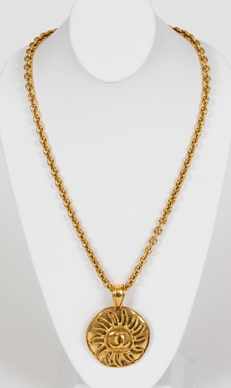 Chanel autumn '94 long round sun pendant necklace. Comes with original box. Pendant, 3