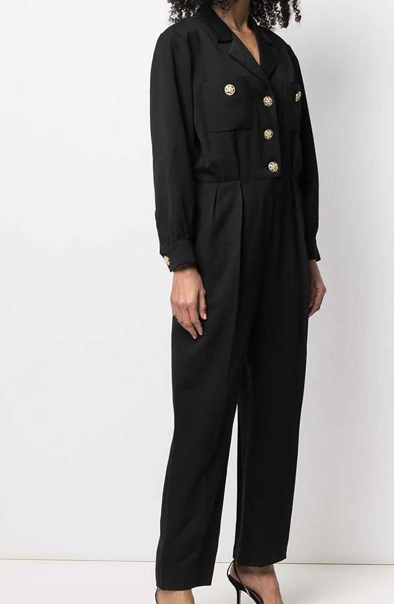 1994 Yves Saint Laurent  black evening jumpsuit featuring front jewel buttons, sides pockets, front patch pockets, shoulder pads. 100% Wool Estimated size 40fr/US8/UK12  In excellent vintage condition.  Made in France.  We guarantee you will receive