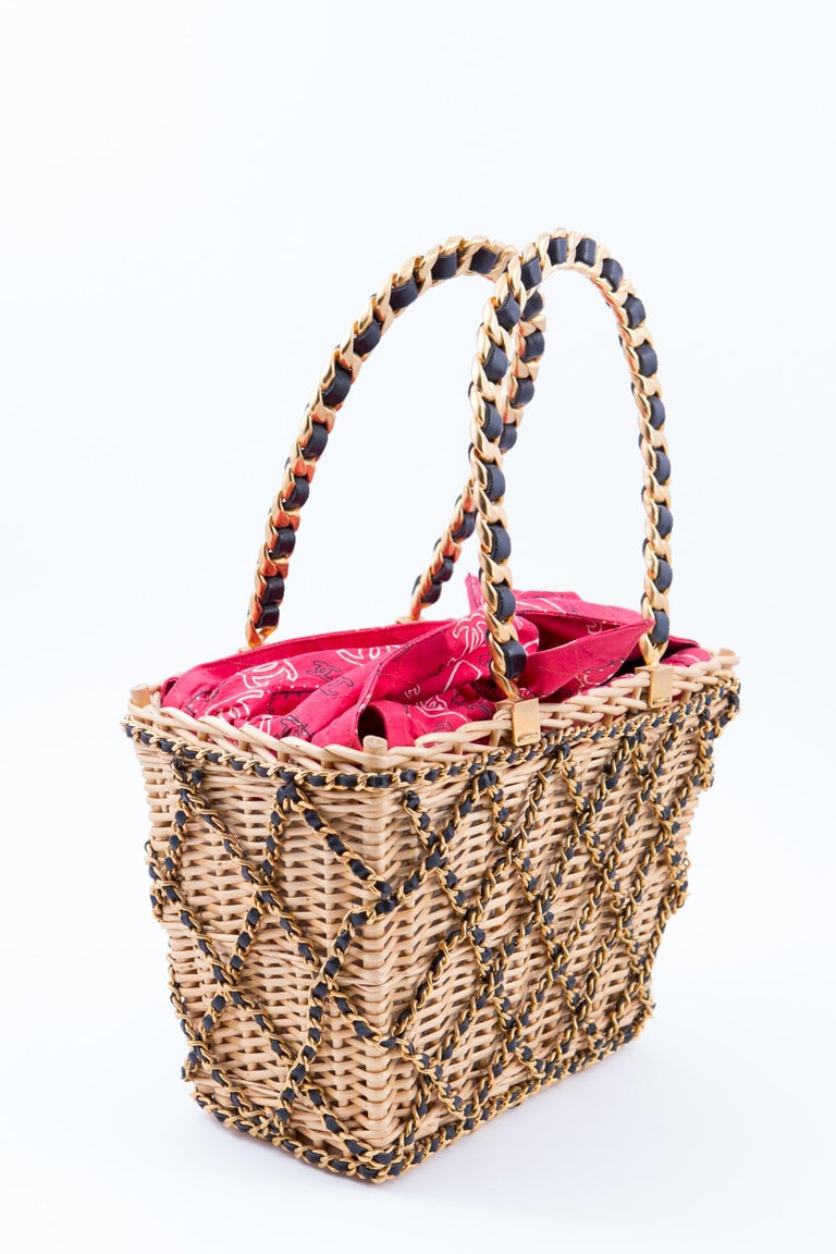 1994s Chanel collector wicker basket bag featuring chain embellished, a red bandana scarf lining cotton detail. See attached 1994s catwalk images. Osier Willow 100%, Straw 100%, Leather 100% Made in France. In good vintage condition.  Length: