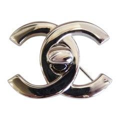 1996 Autumn Chanel Mademoiselle Turn Lock Brooch