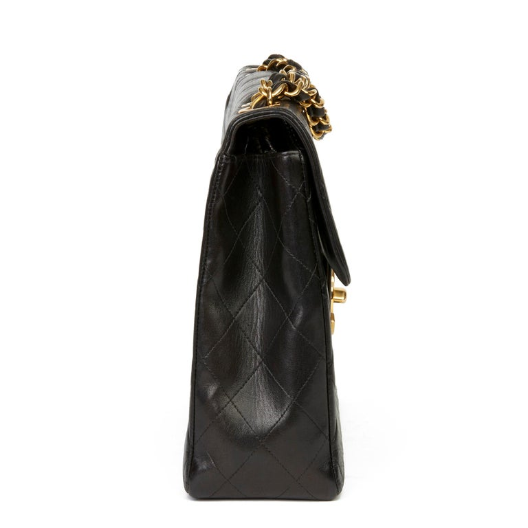 CHANEL Black Quilted Lambskin Vintage Jumbo XL Flap Bag  Xupes Reference: HB3403 Serial Number: 4407170 Age (Circa): 1996 Authenticity Details: Serial Sticker (Made in France) Gender: Ladies Type: Shoulder  Colour: Black Hardware: Gold (24k
