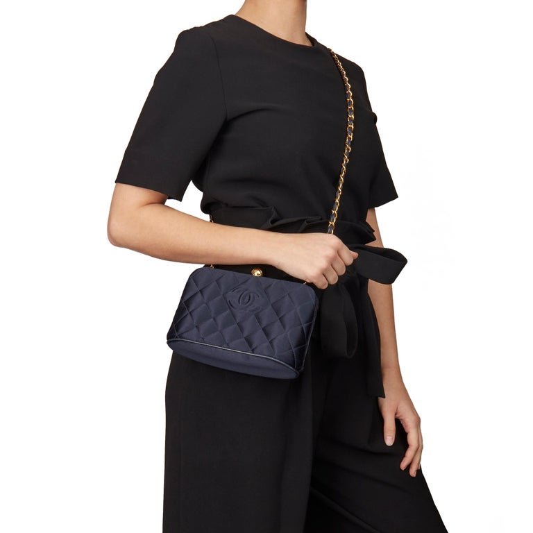 CHANEL Navy Quilted Satin Vintage Timeless Frame Shoulder Bag  Xupes Reference: HB3148 Serial Number: 3484506 Age (Circa): 1996 Authenticity Details: Serial Sticker (Made in Italy) Gender: Ladies Type: Shoulder   Colour: Navy Hardware:
