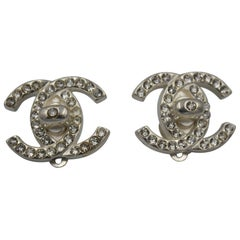 b6300f175 1996 Chanel Vintage Trunlock Earrings xith Swarovski Crystals