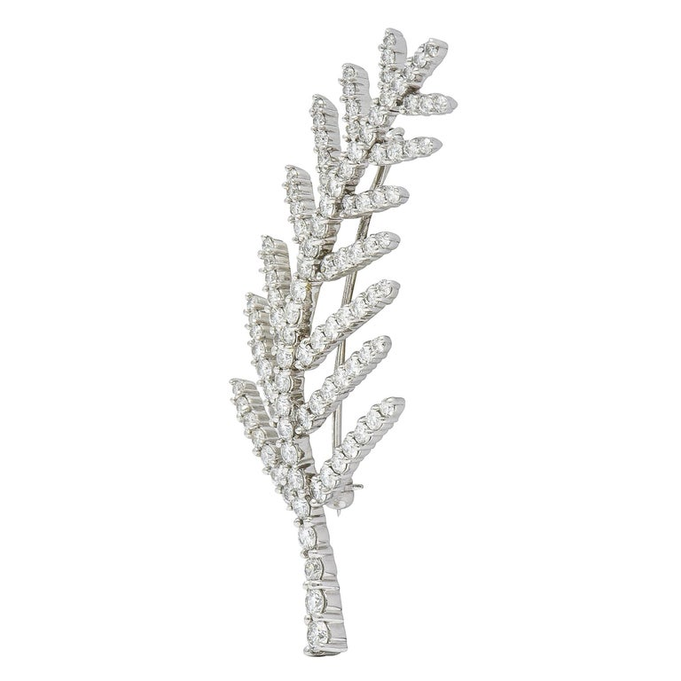 Two matching brooch clips designed as stylized palm leaves  Prong set throughout by round brilliant cut diamonds  Weighing in total approximately 7.00 carat with F/G color and VS clarity  Completed by pin stems and locking closures  Stamped PT950