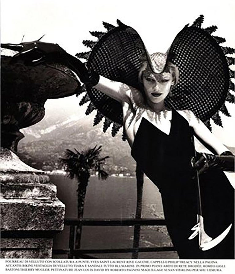 Iconic 1996s Yves Saint Laurent black raven velvet strapless dress featuring a slim fit, a v-neck, a long length and a pointed bustier. See attached Helmut Newton image in Vogue Italia. 65% Viscose 35% Cupro In excellent vintage condition. Made in