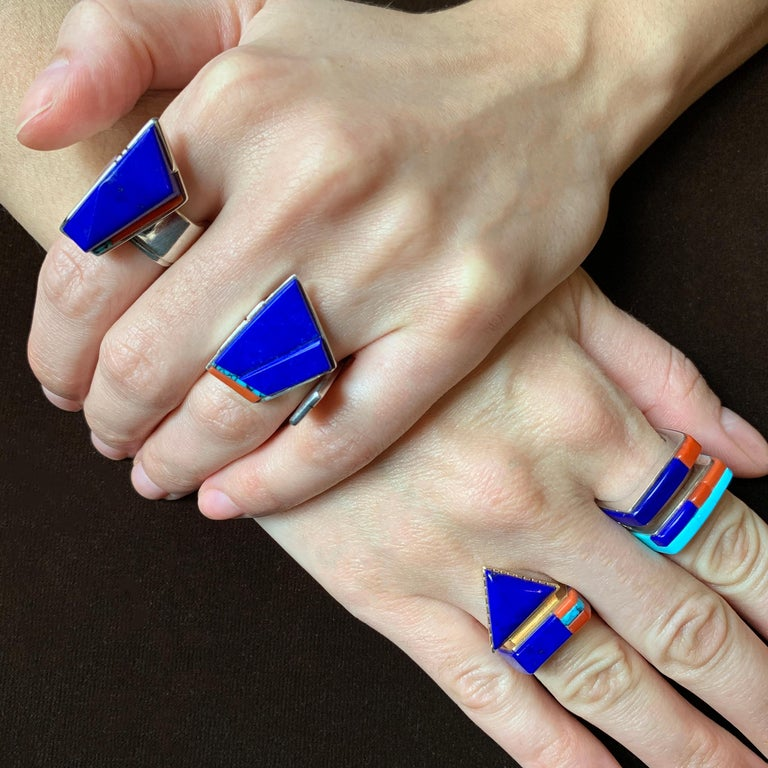 A lapis lazuli, coral, turquoise and 14 karat gold ring, by Richard Chavez, 1997. Signed with maker's mark. Ring size 7. Chavez (San Felipe Pueblo), goldsmith and lapidary, is the master of minimalism, as well as color and form, and an early devotee