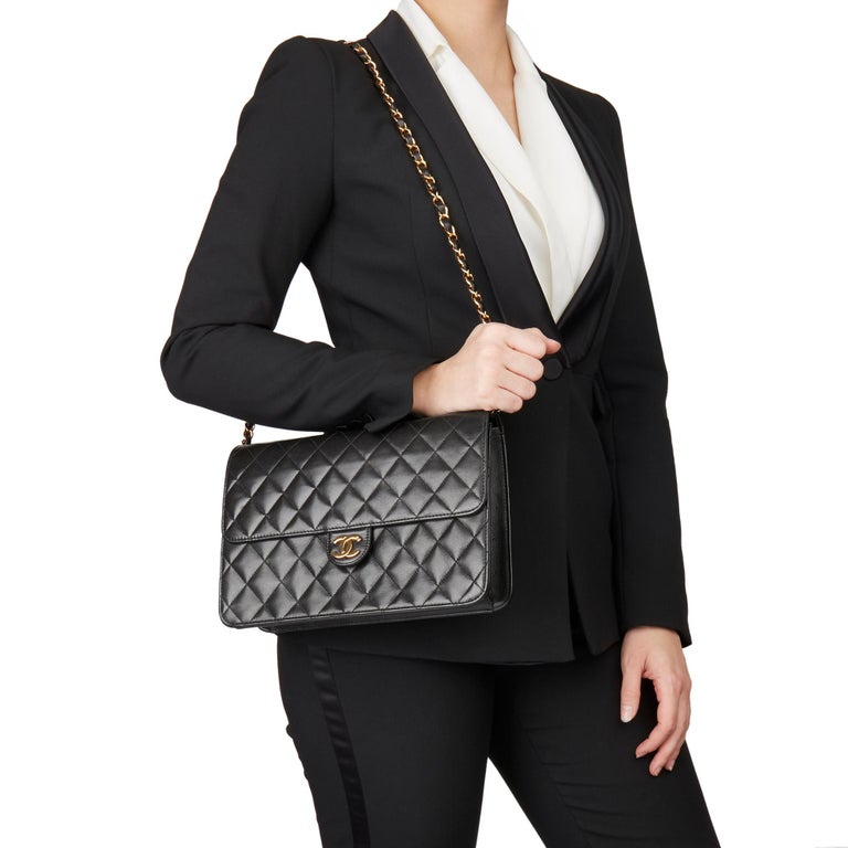 CHANEL Black Quilted Lambskin Vintage Medium Classic Single Flap Bag   Xupes Reference: HB3185 Serial Number: 5269097 Age (Circa): 1999 Accompanied By: Chanel Dust Bag, Box, Authenticity Card, Care Booklet Authenticity Details: Serial Sticker,