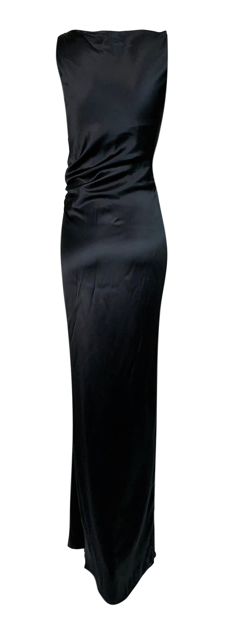 DESIGNER: 1999 Gucci by Tom Ford  Please contact for more information and/or photos.  CONDITION: Good- No holes or stains- fabric tag removed.  FABRIC:  Silk  COUNTRY MADE: Italy  SIZE: 38  MEASUREMENTS; provided as a courtesy only- not a guarantee