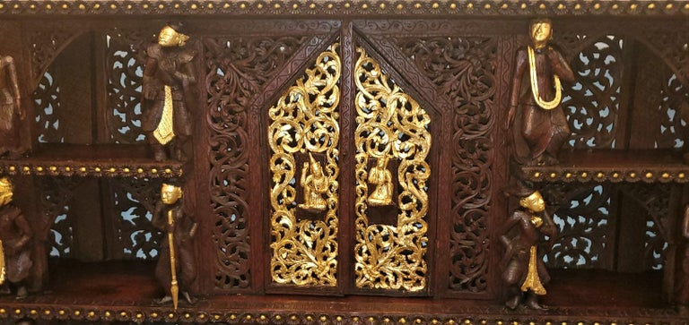 Hand-Carved 19th Century SE Asian Highly Carved Wooden and Gilted Floor Case For Sale