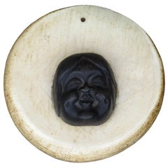 19th-20th Century Alaskan Bronze Face on Round Whale Bone Plaque