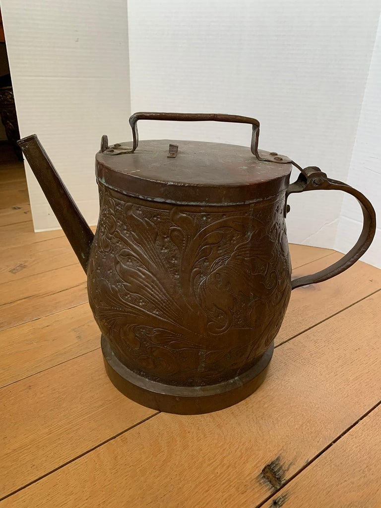 19th-20th century eastern continental copper watering can with lid.