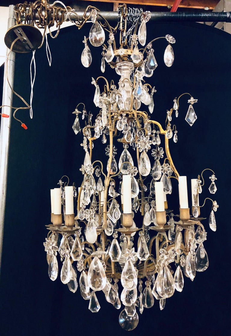 Fine 19th-20th century Louis XVI style 12 light bronze and rock crystal chandelier. Spectacular in a word. This Fine chandelier has recently been removed from a New Cannan Ct Mansion. The bronze frame having one dozen lights with two rock crystal