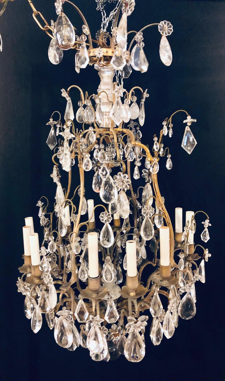 French 19th-20th Century Louis XVI Style 12 Light Bronze and Rock Crystal Chandelier For Sale