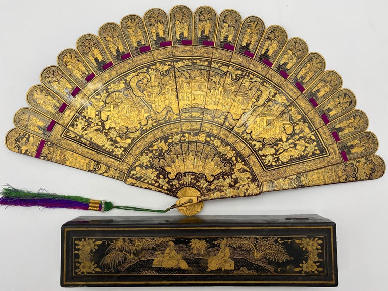19th century antique Chinese hand painted gold lacquer scene gilt fan 100 faces with original lacquer box, fan is 17 inch x 9.5 x 1, the lacquer fan box is 10.5 x 2.5 x 2 inch.