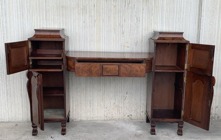 Mahogany veneered Biedermeier vanity desk with two pilaster as well as columns at the front with ebonized bases and capitals. The doors are opened via a pressure mechanism. The tabletop has a drawer and the interior columns consists of several