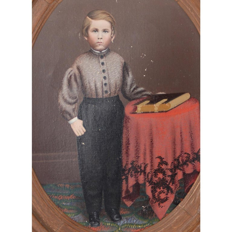 19th century American oil portrait of a young man with his bible  Wonderful 19th century oil portrait.   The sitter is a young man standing proudly next to his most prized possession, his bible.  Oval canvas dimensions: 16