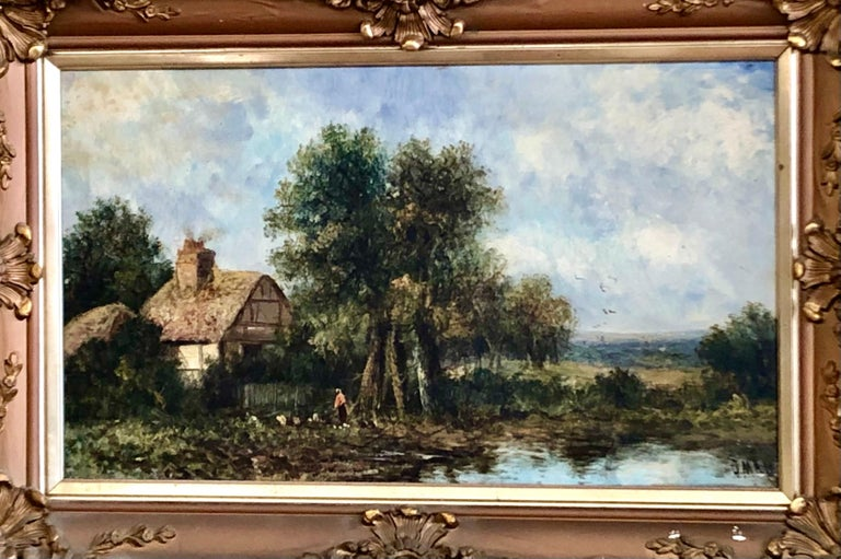 A lovely British 19th century original oil on canvas in its original gilt carved wood and gesso frame (some a/f to frame as illustrated). A wonderful, pastoral landscape of a thatched cottage by a lake; well done by a talented 19th century artist.
