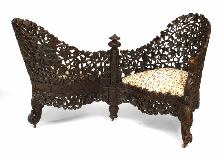 Burmese style (19th Cent) carved and filigreed rosewood tete a tete.