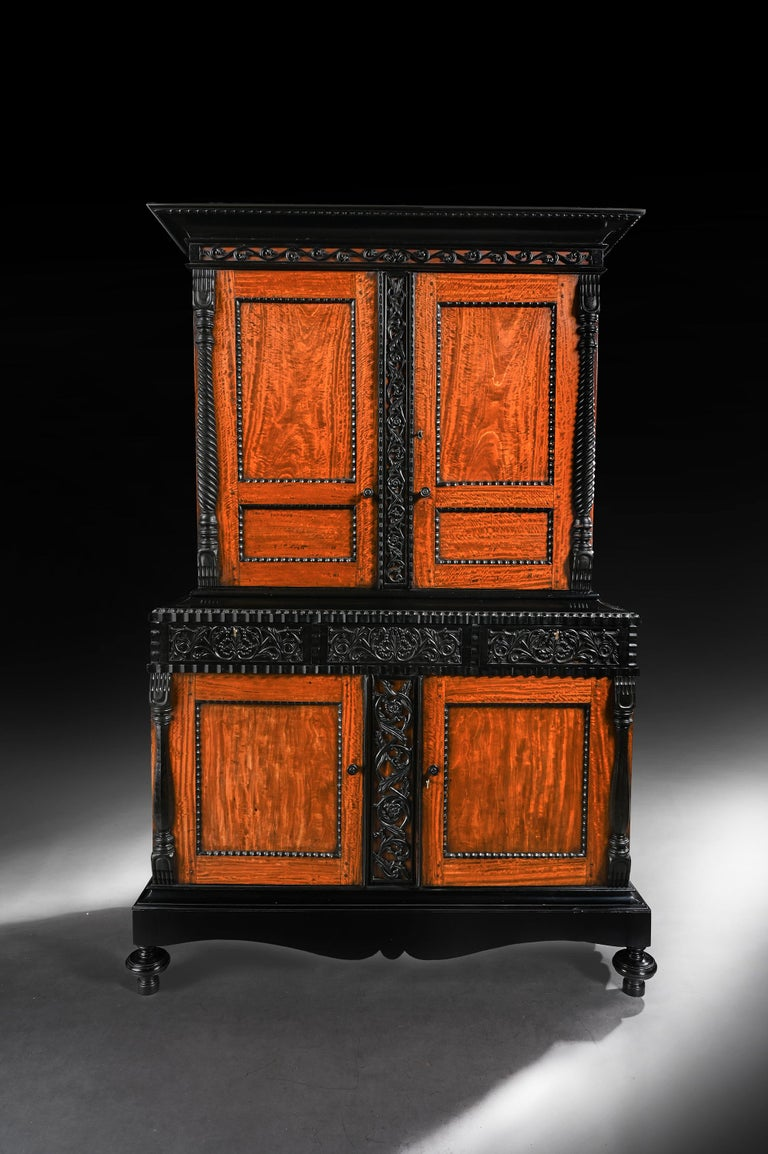 A fabulous exhibition quality 19th century Ceylonese Indo-Dutch solid satinwood and ebony cabinet.  Ceylon (Sri Lanka), circa 1830.  A stunning and rare Dutch Colonial satinwood cabinet / armoire with ebony carved detail.  The solid ebony