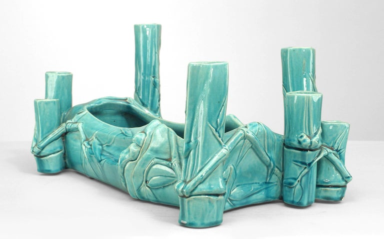 Rectangular porcelain centerpiece with a turquoise bamboo design and two-tiered vase corners.