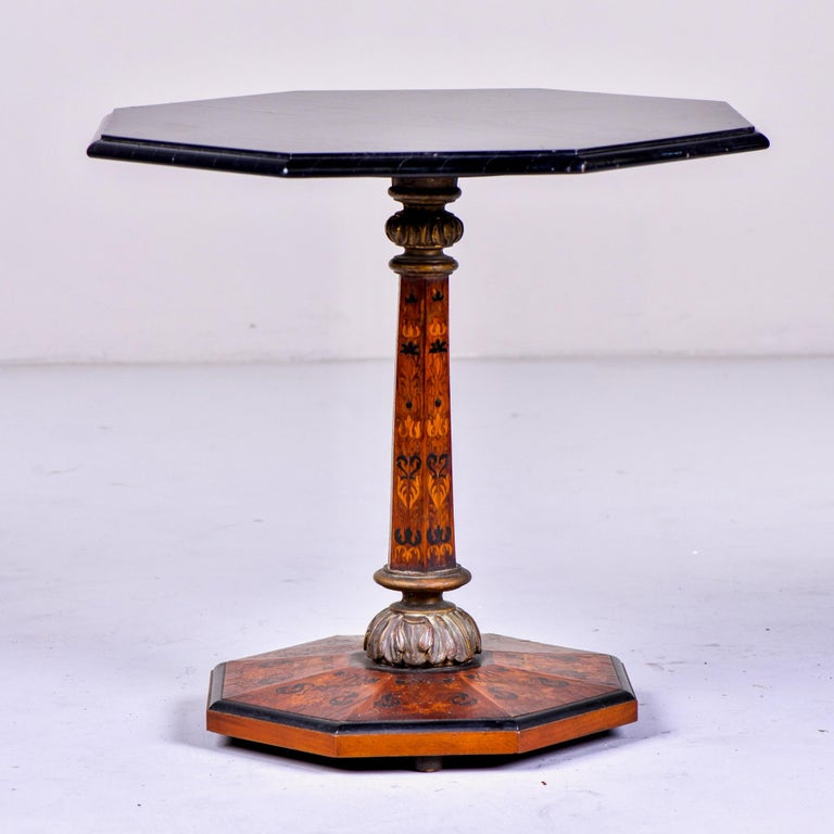 English side table features an octagonal base and center support with marquetry and an eight-sided black lacquered top, circa 1880s. Unknown maker.