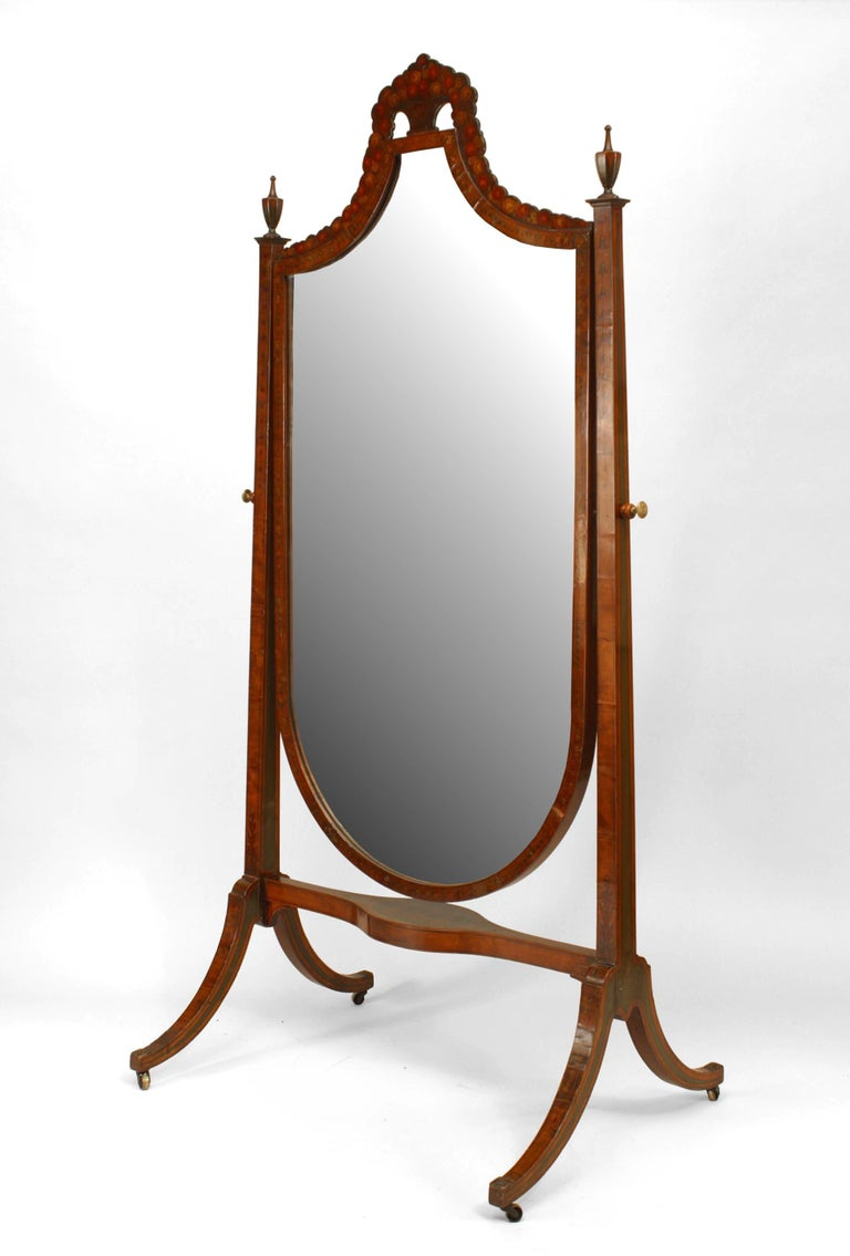 Nineteenth century English Sheraton style satinwood cheval mirror suspended by brass pivot screw supports and adorned with twin finials as well as painted and carved decorations, including a stretcher painted with a multi-figural scene and an urn