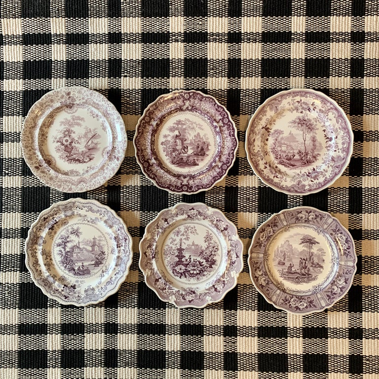 An assembled set of six different patterns of purple on white earthenware Transferware dinner plates, Staffordshire, England, circa 1822-1887, 19th century.  The patterns include:  Carolina– Maker: Ralph Hall & Co. Tunstall, Staffordshire –
