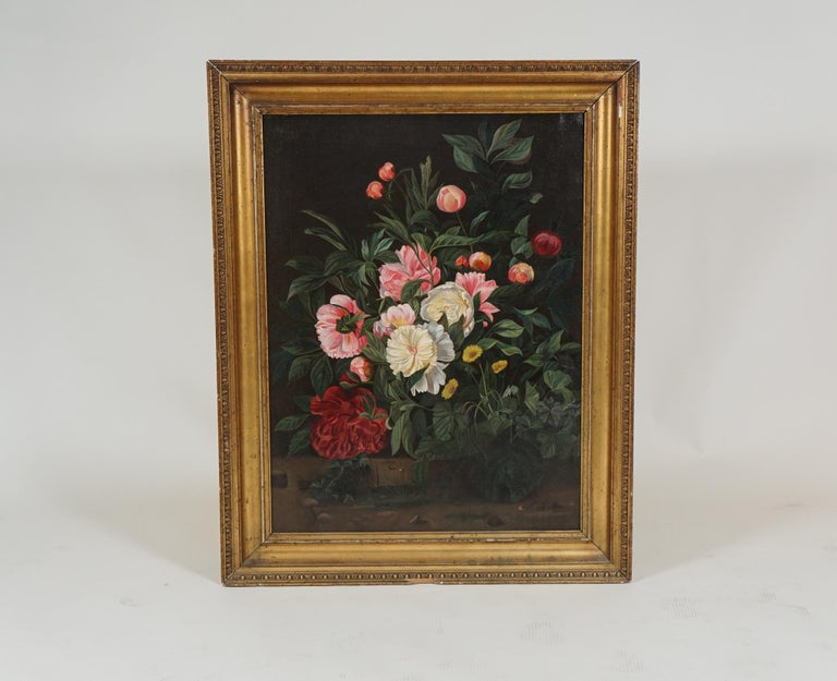 Mid-19th century European flower painting, in the style of the Dutch school, depicting a bouquet of peonies, with yellow daisies on a black background. Original gilded frame.