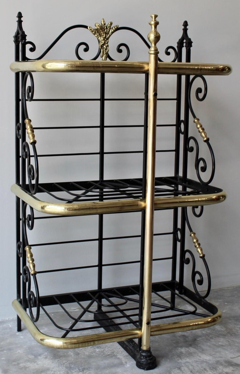 Iron and brass French table or counter top bakers rack. Made in France circa 1890 of the highest quality this Bakers Rack is exceptional in its petite size. Originally made for baked goods, this rack could easily and elegantly be used for storage of