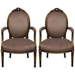 French Louis XIV Style Ebonized and Parcel-Gilt Bergère Chairs, a Pair
