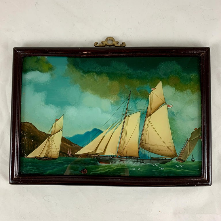 """From France, a reverse glass painting of sailboats on the sea – """"Voiliers Sur la Mer."""" circa late 19th – early 20th century.  Reverse painting on glass is a traditional art form where the artist applies paint to a piece of glass, and the image is"""