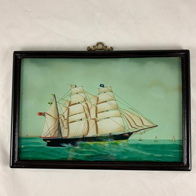 """From France, a nautical theme reverse glass painting of a 19th century Frigate under full sail on the sea – """"Frigate Sur la Mer."""" circa late 19th – early 20th century.  Reverse painting on glass is a traditional art form where the artist applies"""